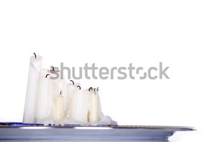 Candles burning low on silver platter Stock photo © jarenwicklund