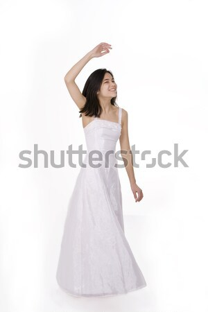 Beautiful young teen girl in white dress or gown twirling Stock photo © jarenwicklund