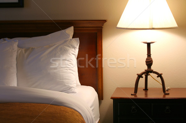 Comfortable, relaxing bed with lamp on side table Stock photo © jarenwicklund