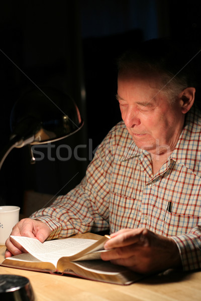 ELderly man reading Bible  with lamp at night Stock photo © jarenwicklund