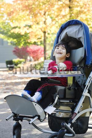 Disabled boy in medical stroller outdoors Stock photo © jarenwicklund