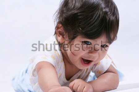 Happy smiling baby learning to crawl Stock photo © jarenwicklund