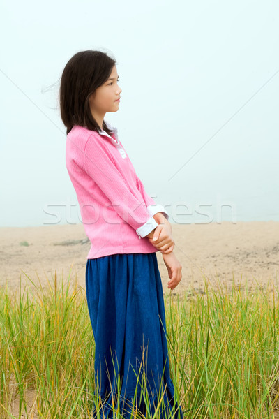 Young girl quietly standing on misty foggy field Stock photo © jarenwicklund