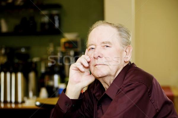 Idős férfi kávéház ül egyedül asztal Stock fotó © jarenwicklund
