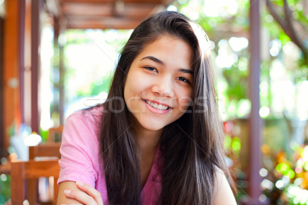 Young teen girl relaxing outdoors on veranda Stock photo © jarenwicklund