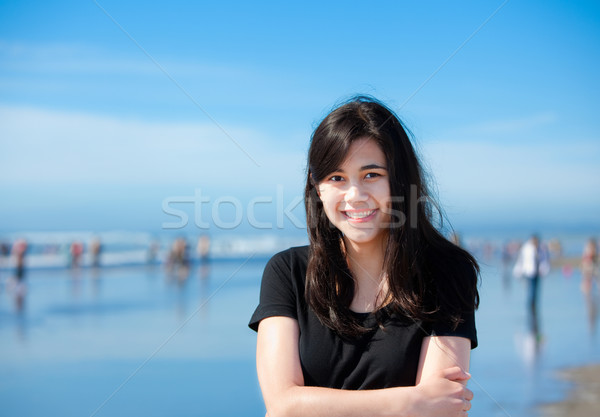 Beautiful biracial young woman or teen walking along beach by Pa Stock photo © jarenwicklund