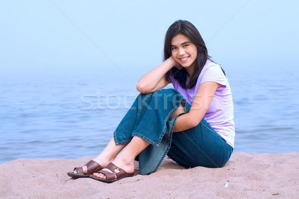 若い女の子 座って ビーチ 小さな 十代の少女 湖 ストックフォト © jarenwicklund