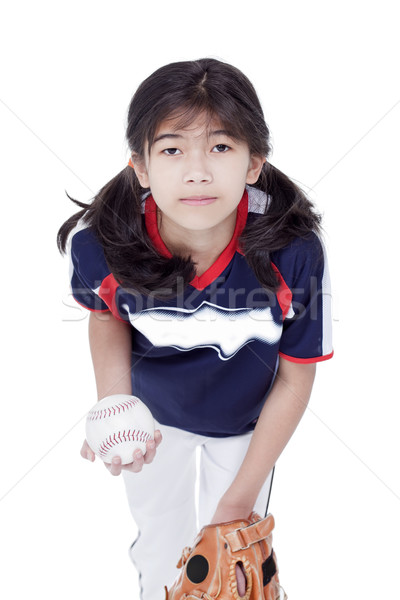 Little girl in softball team uniform ready to throw a pitch Stock photo © jarenwicklund