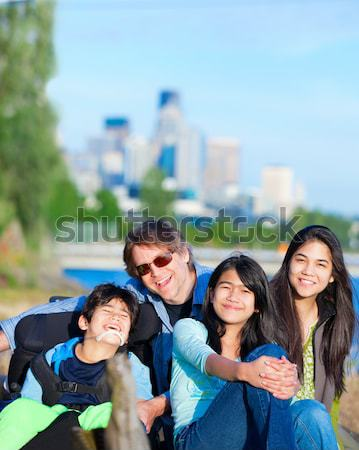 Father and mother with children at park, surrounding disabled so Stock photo © jarenwicklund