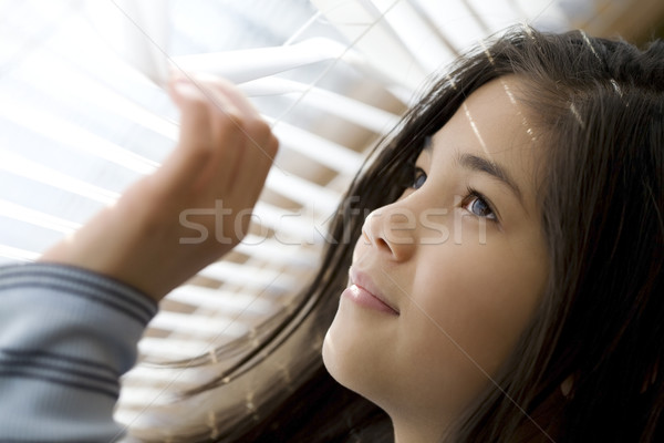 Girl looking out window through blinds Stock photo © jarenwicklund