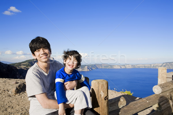 Big brother holding disabled little boy Stock photo © jarenwicklund