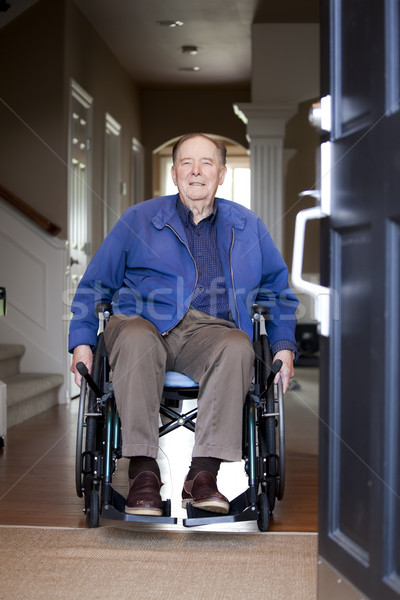 Elderly man in wheelchair at his front door Stock photo © jarenwicklund