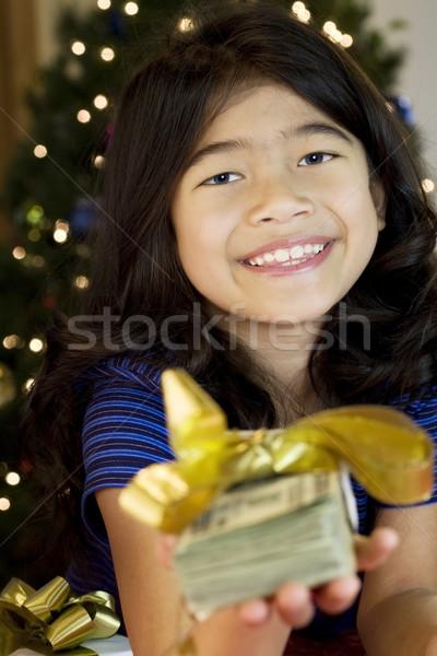 Kislány magasra tart nagy mennyiség pénz karácsony Stock fotó © jarenwicklund