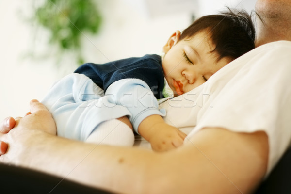 Biracial baby boy asleep on father's chest Stock photo © jarenwicklund