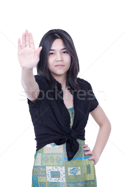 Young biracial teen girl putting hands up to say 'stop', one han Stock photo © jarenwicklund
