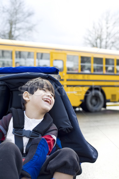 Disabled five year old boy in wheelchair, by schoolbus Stock photo © jarenwicklund