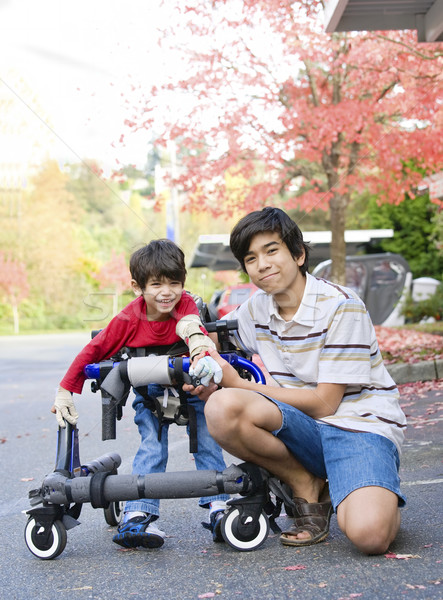 Teen boy with disabled little brother Stock photo © jarenwicklund