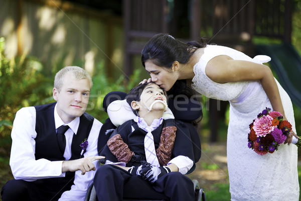 Biracial bride kissing her little brother on her wedding day. Ch Stock photo © jarenwicklund