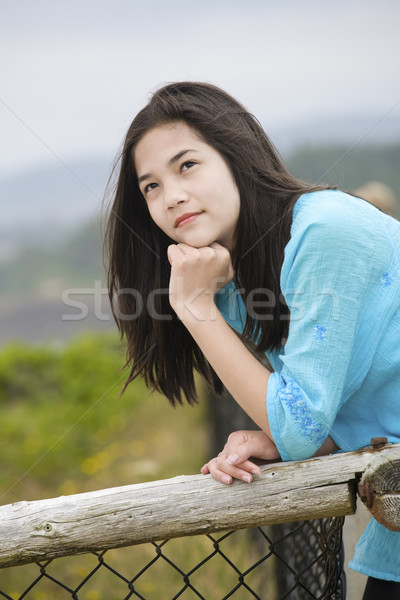 Preteen biracial girl by ocean shore with a thoughtful look, loo Stock photo © jarenwicklund