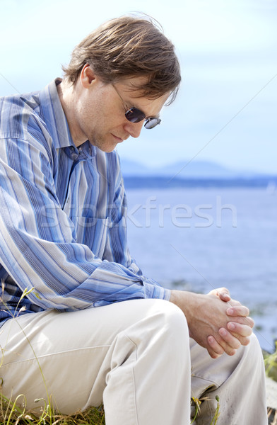 Jóképű férfi negyvenes évek imádkozik oldal tó jóképű Stock fotó © jarenwicklund