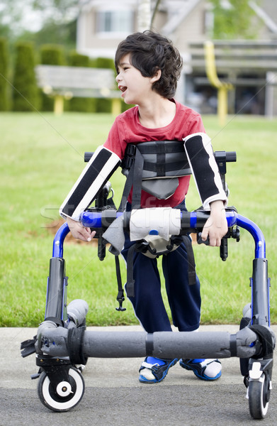 Five year old disabled boy in walker by park. He has cerebral pa Stock photo © jarenwicklund