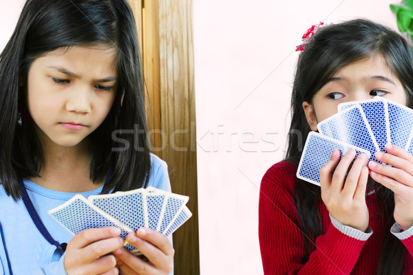 Stock photo: Girls playing cards, one is cheating