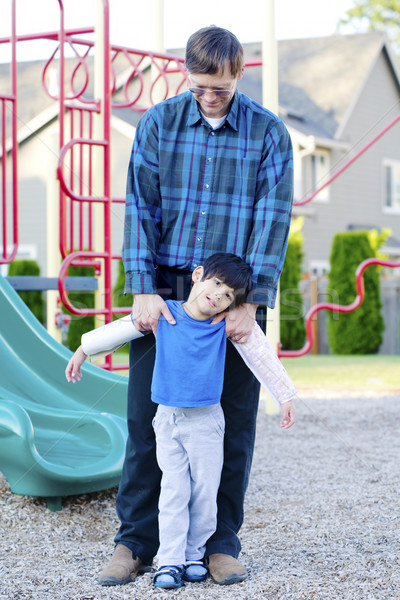 Father helping disabled son at playground Stock photo © jarenwicklund