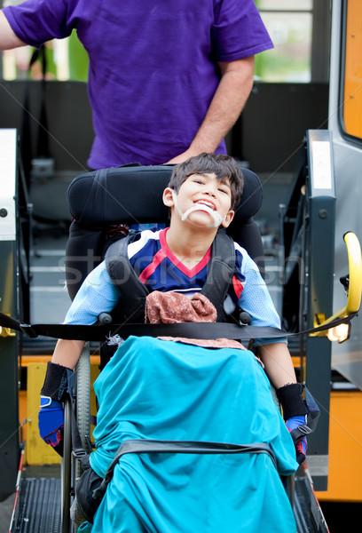 Disabled boy riding on school bus lift Stock photo © jarenwicklund
