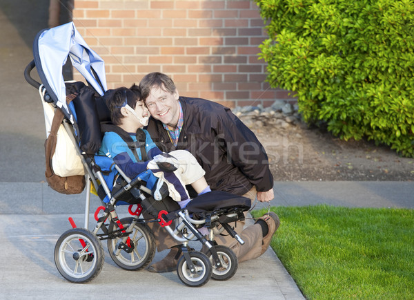 Disabled boy in wheelchair and his caretaker Stock photo © jarenwicklund