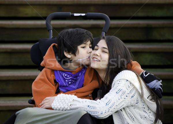 Disabili piccolo ragazzo bacio guancia Foto d'archivio © jarenwicklund