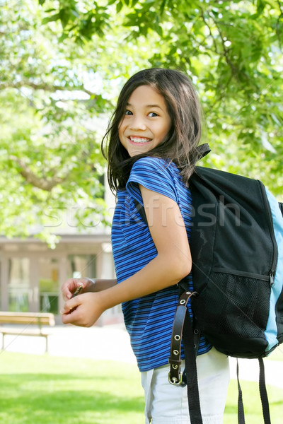 Eight year old girl excited about first day of school.; Stock photo © jarenwicklund