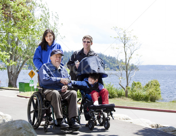 Stock photo: Family with disabled senior and child walking outdoors