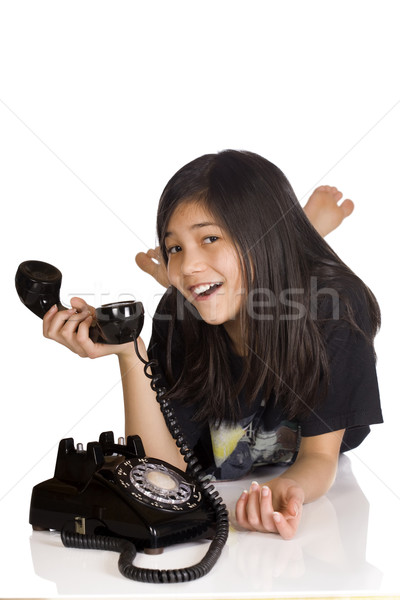 Girl holding old rotary phone Stock photo © jarenwicklund