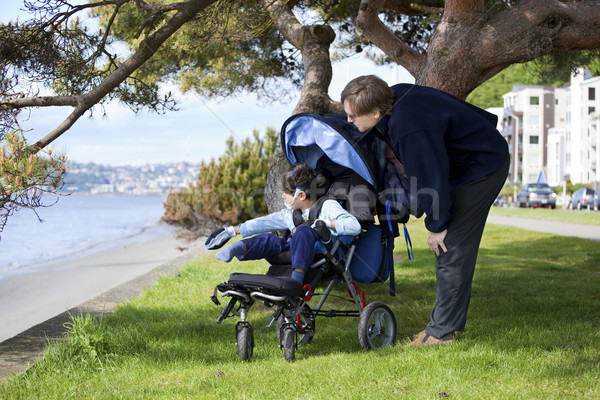 Father spending time with disabled son in wheelchair Stock photo © jarenwicklund