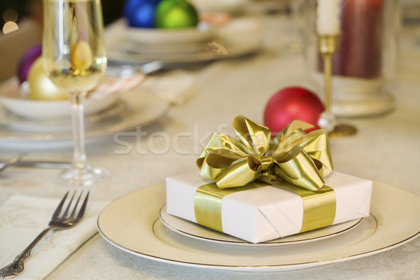 Gold ribbon gift on dining table Stock photo © jarenwicklund