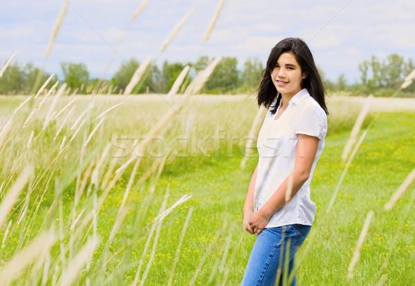 美しい 十代の少女 草で覆われた フィールド 夏 少女 ストックフォト © jarenwicklund