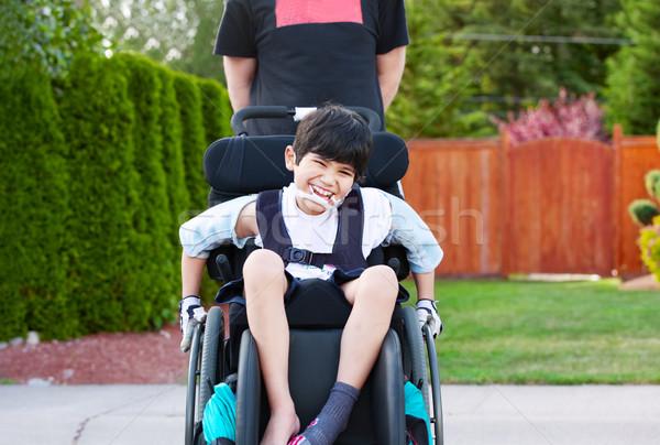 ストックフォト: 幸せ · 無効になって · 少年 · 屋外 · 車いす