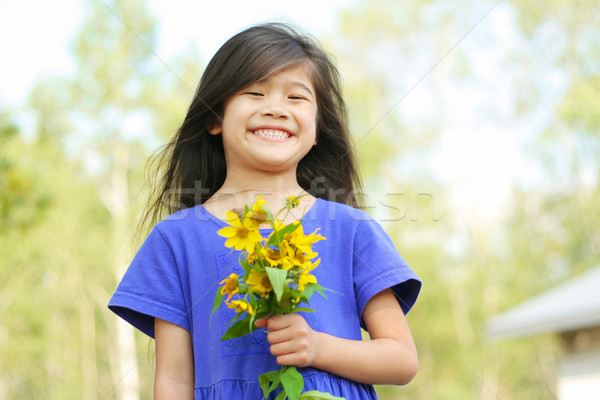 Girl holding bouquet of sunflowers Stock photo © jarenwicklund