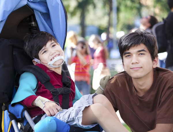 Big brother taking care of disabled little boy in wheelchair  Stock photo © jarenwicklund