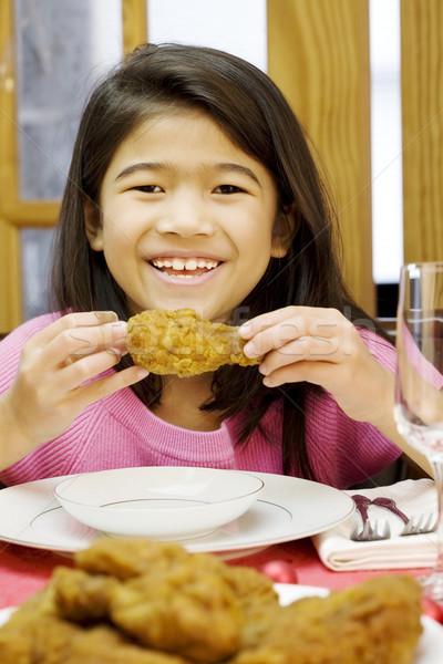 girl eating fried chicken drumstick Stock photo © jarenwicklund