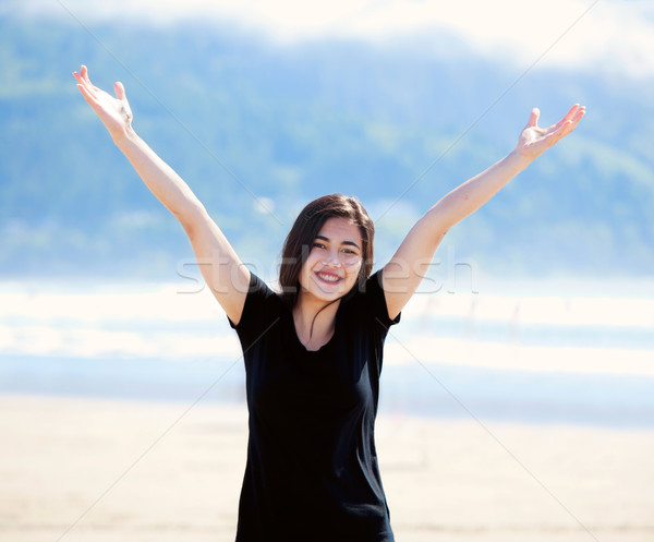 Happy young woman on beach, arms outstretched Stock photo © jarenwicklund