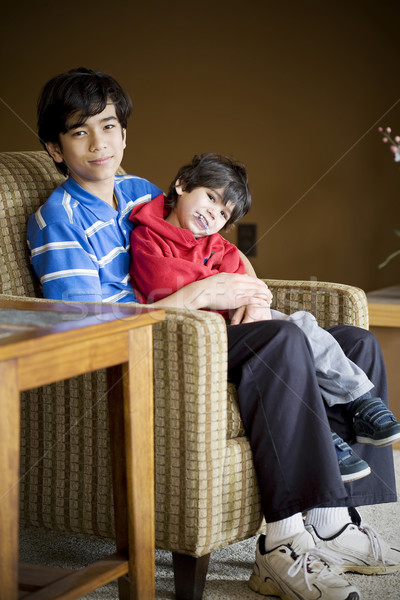 Big brother taking care of disabled sibling with cerebral palsy Stock photo © jarenwicklund