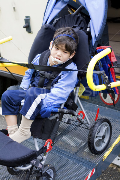 Disabled little boy on school bus wheelchair lift Stock photo © jarenwicklund