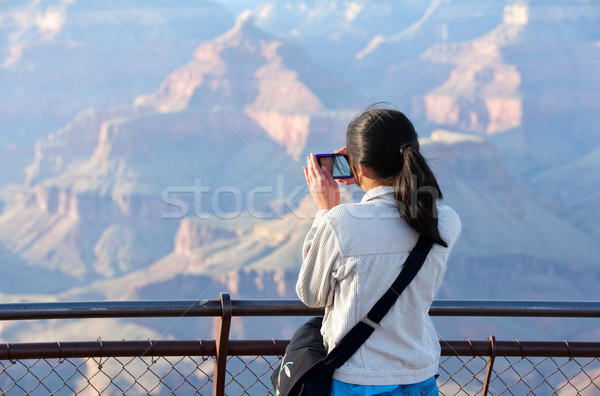 Young teen girl standing at railing taking pictures at Grand Can Stock photo © jarenwicklund