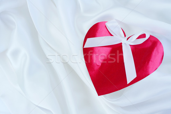 Red heart with ribbon on white satin Stock photo © jarenwicklund