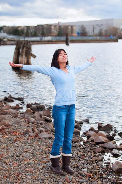 молодые подростка девушка оружия Бога синий рубашку Сток-фото © jarenwicklund