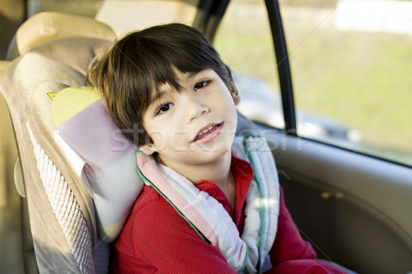 Four year old disabled boy in carseat Stock photo © jarenwicklund
