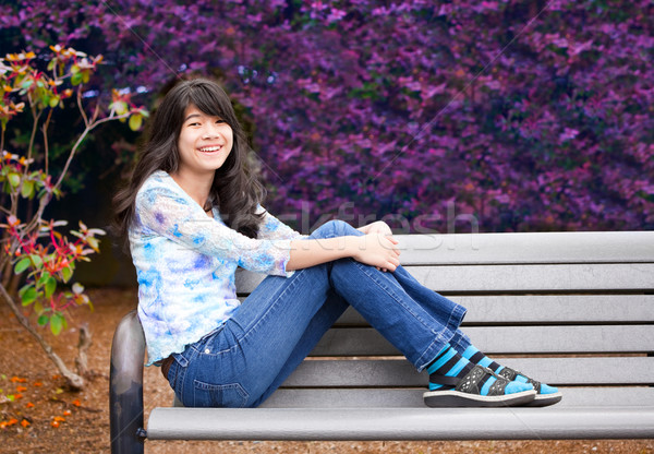 Young preteen girl sitting on park bench outdoors Stock photo © jarenwicklund