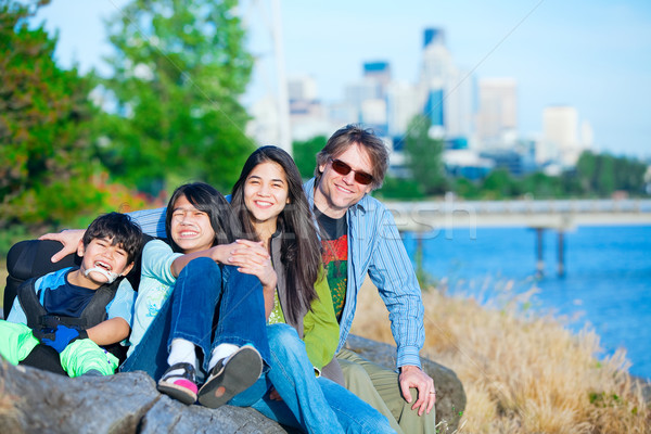 Disabled boy in wheelchair with family outdoors on sunny day, wi Stock photo © jarenwicklund