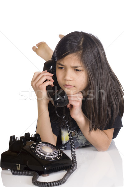 Girl talking on rotary phone, worried expression Stock photo © jarenwicklund